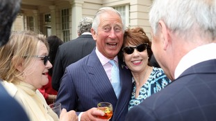 Prince Charles look in good spirits as the garden party.