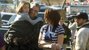Parents pick-up children outside Sandy Hook Elementary School