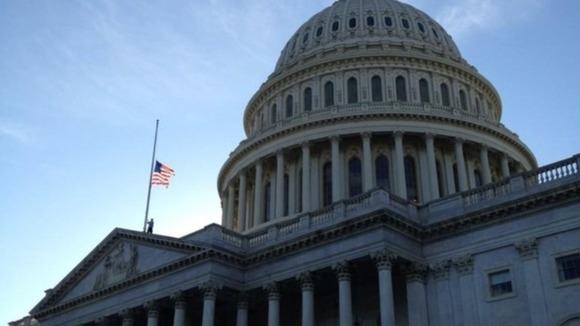 The American flag has been lowered on Capitol Hill in tribute to the victims of the Connecticut mass shooting.