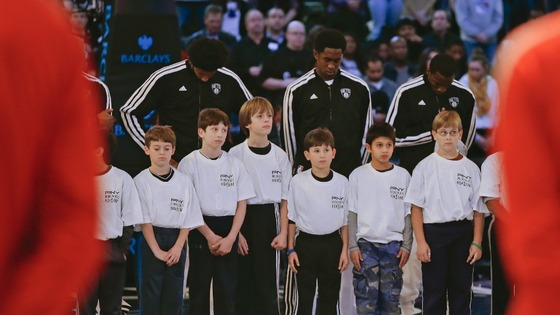 Children join the Brooklyn Nets during a moment of silence for victims of the mass shooting in Newtown, Connecticut