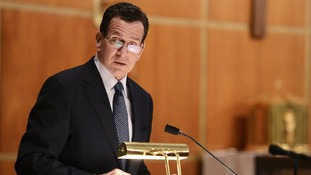 Dannel Malloy, Governor of Connecticut speaks to mourners gathererd inside the St. Rose of Lima Roman Catholic Churc