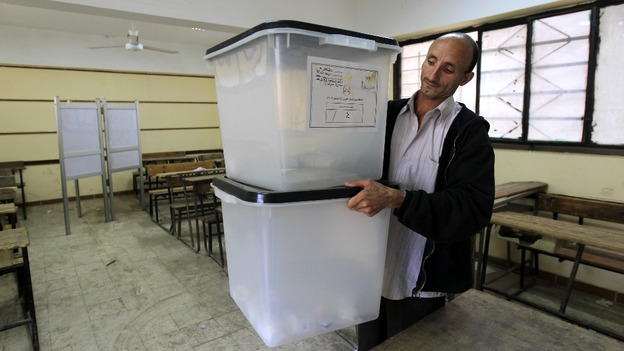 An employee of the constitutional referendum committee prepares a ballot box 