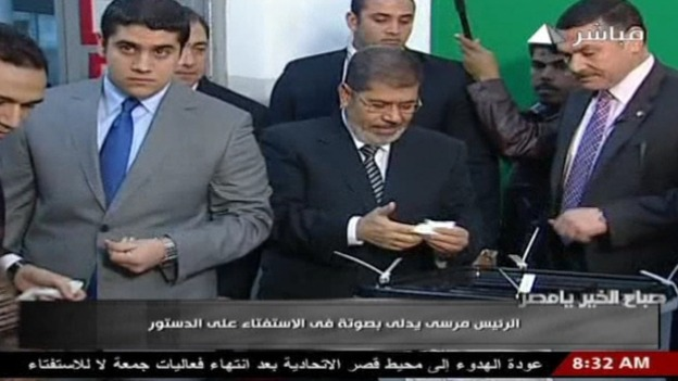 Egyptian President Mohamed Mursi casts his vote in the referendum on the constitution