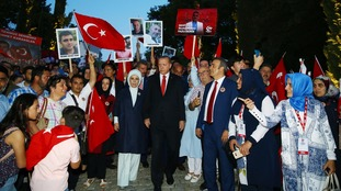 President Erdogan and his wife, Emine, march with relatives of the victims of the coup.