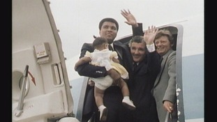 Muhammad Ali waving