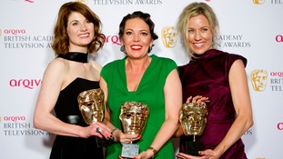 Jodie Whittaker and co-stars Olivia Colman and Simone McAullay after winning the Drama Series Award for Broadchurch, at the 2014 BAFTA Television Awards.