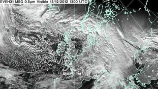 A satellite image shows cloud cover gathering over the UK