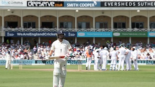 England's Mark Wood walks off after getting out.