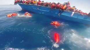 Migrants are rescued from an overcrowded boat.