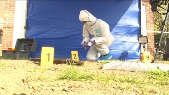 Forensic officers working on a mock crime scene
