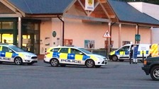 Police outside the Morrisons supermarket in Wymondham.