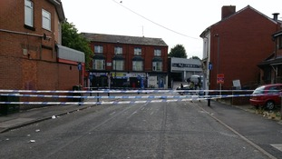 The road remains closed after a man was shot in the leg
