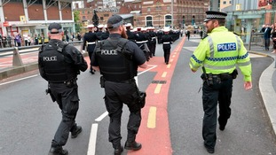 Armed police patrolling on armed forces day.