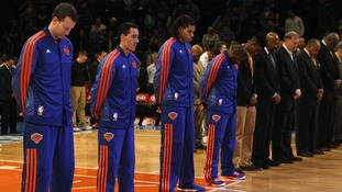 Members of the New York Knicks observe a moment of silence