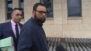 Farook Bhikhu, right, and his lawyer outside court in June