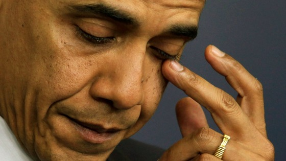 President Barack Obama wiping away tears at a press conference on Friday