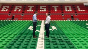 Why our sports reporter is standing in a giant lego stadium...
