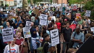 A large crowd protested outside Kensington Town Hall.