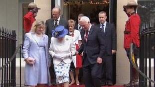 Canada's Governor General breaches royal protocol by touching the Queen