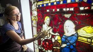 Monika Adamczak from York Glaziers restores Isaac Blessing Jacob on a stained glass window at York Minster.