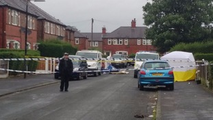 Police begin their investigation on Royton Avenue in Sale