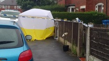 Police erect small tent and cordon off part of Royton Avenue in Sale