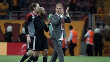 Ostersund's manager Graham Potter, centre, celebrates with his players following an UEFA Europa League match in Istanbul