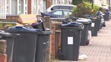Residents have been left with overflowing bins during the dispute