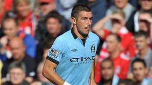The Manchester City player, Aleksandar Kolarov, who is a Serbian international, is believed to have become involved in an exchange with two spectators holding an Albanian flag.