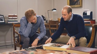 The Princes looking at photos of their mother in the documentary.