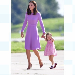 Princess Charlotte holds her mother, the Duchess of Cambridge's hand, as they prepare to board their flight home.