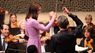 The duchess tries her hand at conducting.