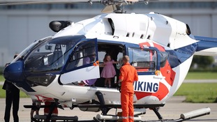 Princess Charlotte explores the cockpit of a rescue helicopter.
