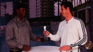 Third placed Sports Personality of the Year 2012, Andy Murray is seen on videolink accepting his award from Lennox Lewis