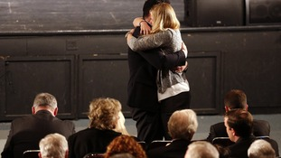 Man and woman embrace during a vigil for families of victims of the Sandy Hook Elementary School shooting