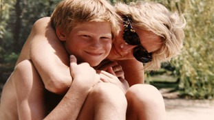 Princess Diana with a young Prince Harry.