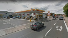Police cordon off petrol station after man threatens to harm himself
