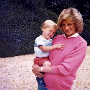 Diana with Prince William while pregnant with Prince Harry.