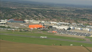 Man arrested at Luton Airport after apparently trying to open door during a flight