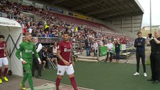 Marc Richards leads the Northampton team out in their new strip.