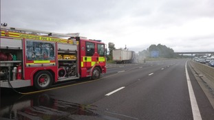 Road closed after lorry catches fire on motorway