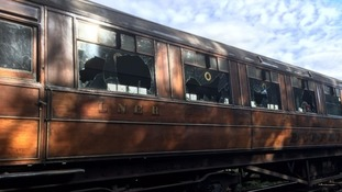 Two boys have been arrested by police investigating a deliberate act of vandalism on vintage railway carriages in Pickering.