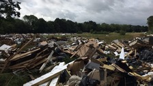 Tonnes of rubbish dumped in a field in South London