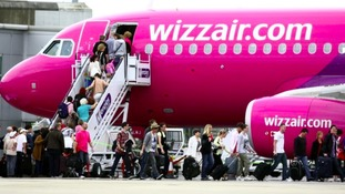 A passenger on a Wizz Air flight had to be restrained on the way to Luton.