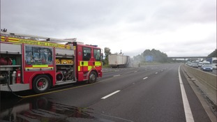 Severe delays after lorry catches fire and spills fuel on motorway