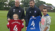Mick McCarthy (left) and Luke Chambers (right) pose with the new shirts.