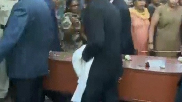 Jacintha Saldanha&#x27;s coffin is carried into church for her funeral.