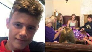 Friends of Owen Jenkins tie purple ribbons around hometown in his memory