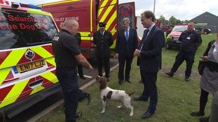Police Minister Nick Hurd is introduced to one of the stars of Essex's dog unit.