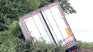 Fruit lorry crashes off A75